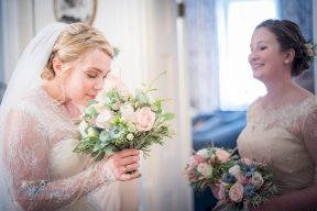 Bride and bridesmaid with bouquets Image by Matthew Williams-Ellis Photography