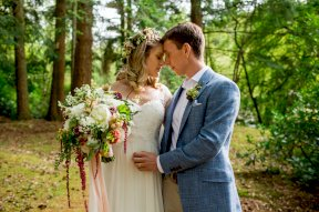 Wedding couple with bouquet with trailing amaranthus, image by Rebecca Roundhill Photography