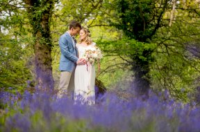 Wedding photo in the spring flowers mage by Rebecca Roundhill Photography