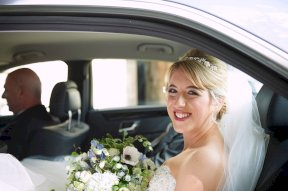 Bride in the car Image by Kevin Wilson Photography